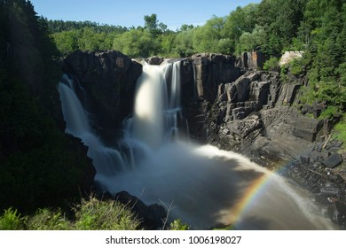 Waterfall with rainbow in Minnesota gorge