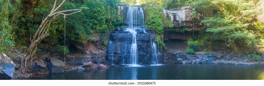 waterfall in a river with silk teepee water