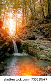 waterfall of river water in the forest in autumn