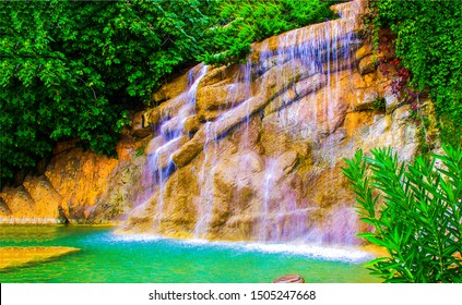 Waterfall rock in tropical forest. Tropical forest waterfall. Waterfall pool in forest. Forest waterfall view