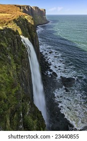 Waterfall at Scottish coast with cliffs in the background