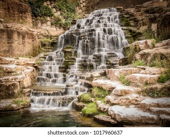 A waterfall with several rocks