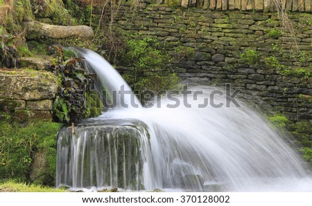 waterfall stone sculpture alligator head village stock photo edit