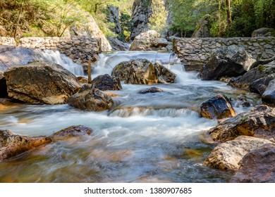 Waterfall with stones in wild nature in Fragas de Sao Simao, Figueiro dos Vinhos, Leiria, Portugal.