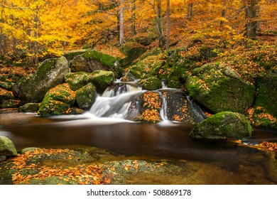Waterfall at Stream Cerny potok in autumn, Giant mountains, Jizerske hory, Czech republic
