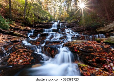 Waterfall with sunset in the background, fall colors, north Georgia USA
