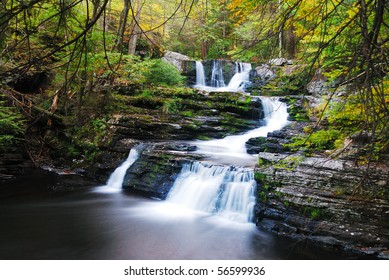 Waterfall with trees and rocks in forest in mountain in Autumn. From Pennsylvania Dingmans Falls.