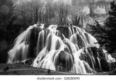 Waterfall of Tufs near the Jura mountain French village of Baume-Les-Messieurs , Franche Comte, France