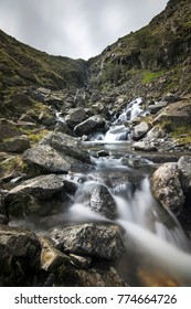 Waterfall valley with beautiful creek with pure white water in Cumbria Lake District England