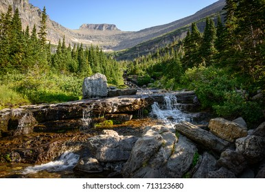 Waterfall in Valley at Glacier National Park