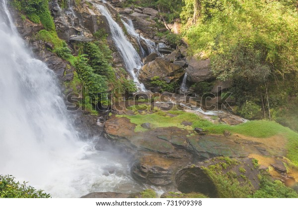 Waterfall and water spray in the air with the rain forest surround at Wachirathan Waterfall,Doi Inthanon National Park,Chiang Mai province,Northern Thailand.
