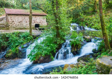 Waterfall and watermill in Armenteira river on the stone and water route in Meis town, Galicia, Spain