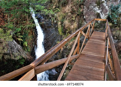 waterfall The well of hell in Serantes, A Coruna, Galicia, Spain, Narrow and dangerous path in the forest to see a waterfall,