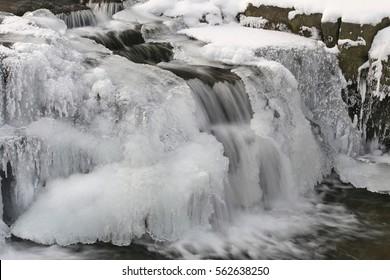 Waterfall in winter. Mohelnice river, Beskydy, Czech republic.