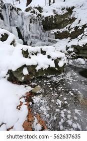 Waterfall in winter. Tosenovsky river, Beskydy, Czech republic.