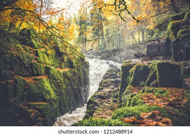 Waterfall in the Woodlands during autumn in the Hermitage, Dunkeld