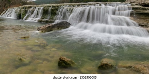 Waterfalls along the urban oasis of the Bull Creek are a popular and dog-friendly spot for hiking, swimming, and taking in the beautiful scenery of the Hill Country in the heart of Austin, Texas