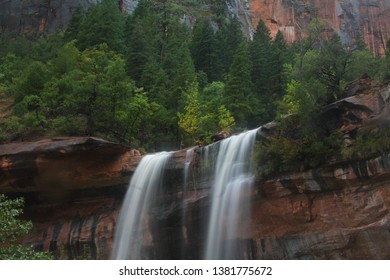 Waterfalls appear below Emerald Pools at Zion National Park, Utah