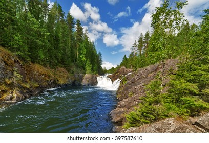 waterfalls between rocks with green forest