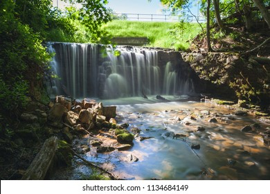 Waterfalls of Ieriku nature park at old watermill in the forest. It's a part of Gauja National park, Latvia.