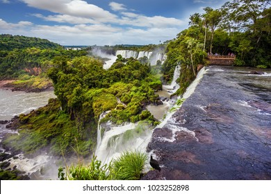 The waterfalls Iguazu. Travel to Argentina. Picturesque basaltic ledges form the famous waterfalls. The concept of active and exotic tourism