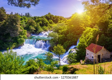 Waterfalls Krka, National Park, Dalmatia, Croatia. View of Krka National Park, Roski Slap location, Croatia, Europe. Beautiful world of Mediterranean countries. Traveling concept background.