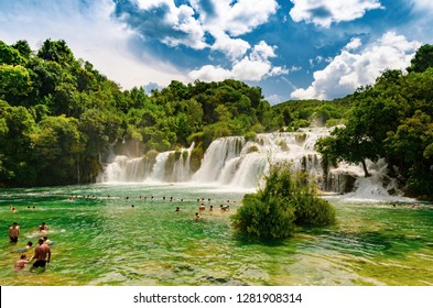 Waterfalls of Krka National Park, Dalmatia / Croatia - 21 July 2014: Tourists swimming near waterfalls in crystal clear water. Tourist spot in Dalmatia Krka National Park, place to go and visit