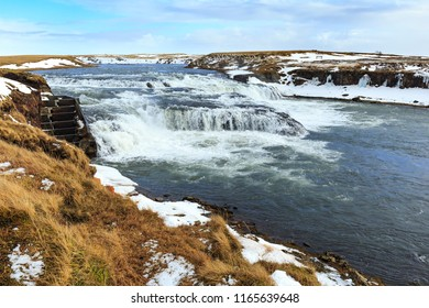 Ægissíðufoss waterfalls located near Hella at route 1, Iceland during Winter season. Ice, snow, water and sunset.