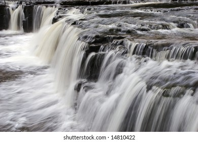 Waterfalls over limestone steps at Aysgarth in Yorkshire