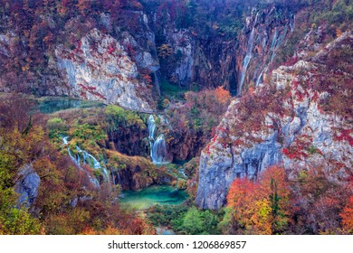 Waterfalls in Plitvice Lakes. Image of autumn landscape in Plitvice National Park with beautiful waterfalls during sunrise in fall.