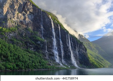 Waterfalls of the Seven Sisters in the Geiranger Fjord after sunrise