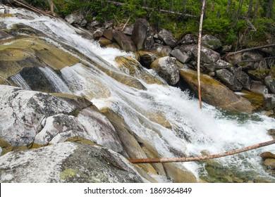 Waterfalls at stream Studeny potok in High Tatras mountains, Slovakia - Shutterstock ID 1869364849
