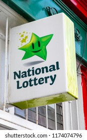 Waterford, Republic of Ireland - August 14th 2018: A sign advertising the Irish National Lottery above the entrance to a shop in the city of Waterford in the Republic of Ireland.