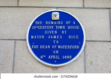 Waterford, Republic of Ireland - August 14th 2018: A plaque in the historic city of Waterford, detailing the history of the remains of a 15th Century Town House given to the Dean of Waterford in 1466.