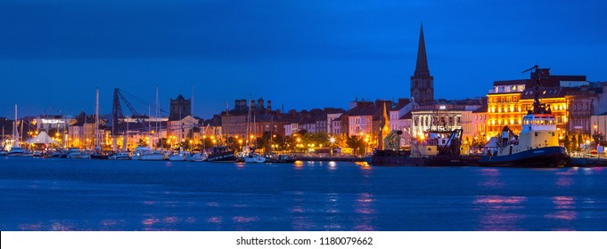 Waterford, Republic of Ireland - August 14th 2018: A dusk-time view of the historic city of Waterford in the Republic of Ireland.