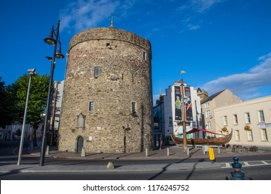 Waterford, Republic of Ireland - August 16th 2018: A view of Reginalds Tower and the Viking Longboat replica named Vadrarfjordr, in the historic city of Waterford, Republic of Ireland.