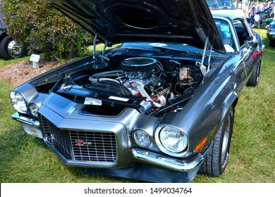 Waterford, Wisconsin / USA - August 28, 2016: Under the hood of a split bumper early second generation Chevrolet Camaro Z28 at the local car show.