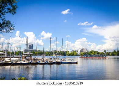 Waterfront of Aussenalster Lake in Hamburg city, Germany. Lake and its shores are used by Hamburg inhabitants for many sport and recreational purposes, such as sailing and rowing
