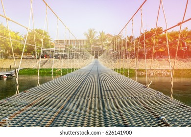 Waterfront is bridge made with sling at in Phetchaburi Province in Thailand on the banks of the river.The result of the cooperation of the two parishes. It is preserve and restore nature along  River.