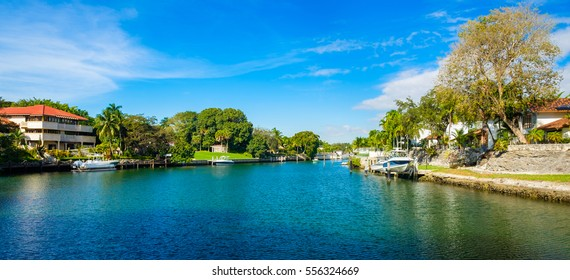 Waterfront homes and boats along a waterway in Miami, Florida.