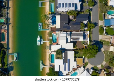 Waterfront homes on the sunny Gold Coast suburb of Broadbeach Waters, QLD, Australia