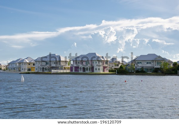 Waterfront homes, sky background