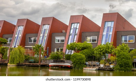 Waterfront houses with integrated solar panels and hanging gardens on waterfront in urban area of The Hague, Netherlands