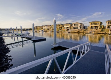 waterfront houses on the river with marina berth