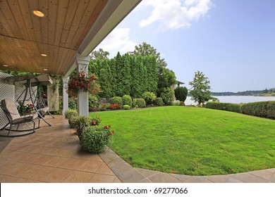 Waterfront lake home with dock and terrace.