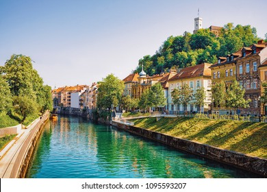 Waterfront of Ljubljanica River and Old castle on Castle hill in the historical center of Ljubljana, Slovenia