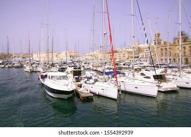 Waterfront marina with yachts and sailboats, Birgu Vittoriosa, Malta