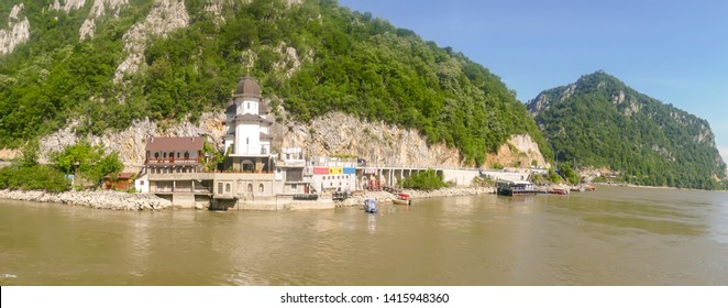 Waterfront Mraconia Monastery  on shores in the Iron Gate gorges on the Danube River between Serbia and Romania.