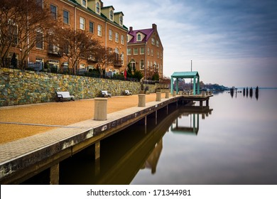 Waterfront promenade and condominiums along the Potomac River in Alexandria, Virginia.