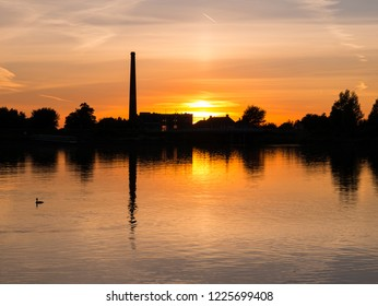 Waterfront silhouette of steam pumping station with museum at sunset, Medemblik, Noord-Holland, Netherlands